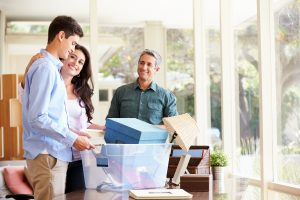 Parents helping son pack for college